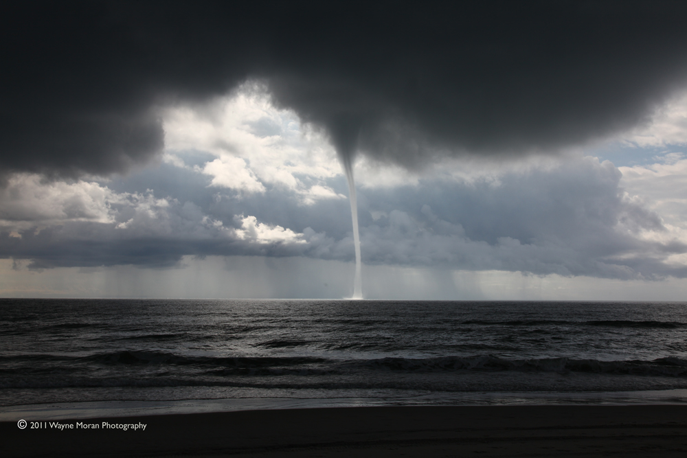 Captured a water spout on the beach in NC